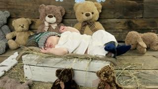 Sleeping child and teddybears. Baby in knitted hat. Healthy sleep habits.