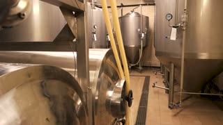 Small brewery, craft beer production. Beer tanks, brewery tanks in brewery storage.