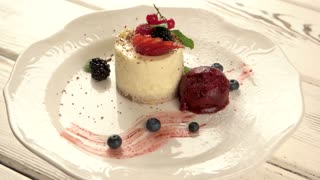 Small cake on plate. Dessert with berries. Cheesecake prepared at restaurant. Stock Video Footage - VideoBlocks & Small cake on plate. Dessert with berries. Cheesecake prepared at ...