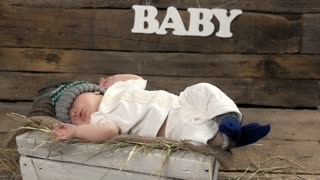 Small child sleeping. Baby and hay.