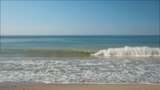 Small wave on seashore. Sea with blue sky. Good spot for summer vacation. Swim and sunbathe.