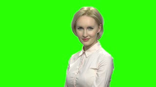 Smiling sexy mature woman in office shirt flirting. Slow motion. Green hromakey background for keying.