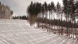 Snowy ski slopes in the mountains. Ski Resort.