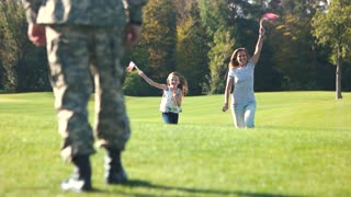 Soldier's family running with usa backgrounds. Americal soldier back home from the military service.
