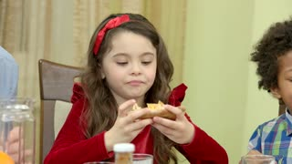 Spicy food reaction. Little girl eating pizza. Too much pepper.