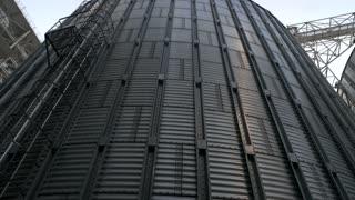 Stainless steel grain bins, up view. Gather of metal buildings.