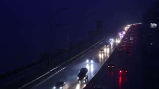 Stream of cars on the highway during rush hour.