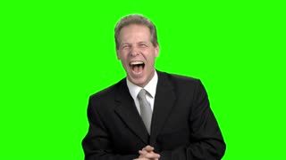 Successful happy businessman screaming up. Man in suit head up and put hands up, green hromakey background for keying.