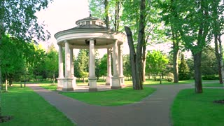 Summer city park. Green park with walkway. Peaceful place for summer relaxation.