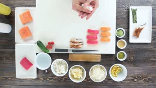 Sushi ingredients on wooden table. Food preparation, japanese cuisine.
