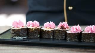 Sushi rolls preparation, caviar. Tasty Japanese food.