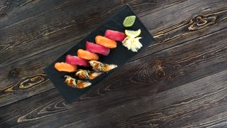 Sushi top view. Japanese food on wooden background.