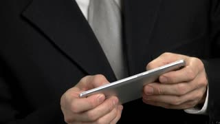 Swiftly tapping smartphone. Male hands playing mobile games. Close up business man hands playing mobile video games.