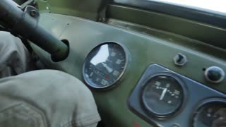 Tachometer in old car. Dashboard on a retro car. Military car. Old pickup truck driving on rough roads.