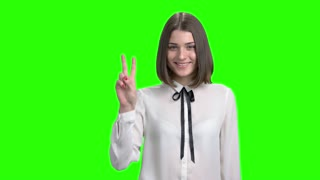 Teen girl in white blouse shows youth gestures. Green screen hromakey background for keying.