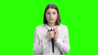 Teenage brunette girl won lottery. Exremely happy young woman rejoicing success. Green screen hromakey background for keying.