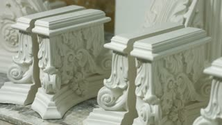 The base of column. Elements of baroque architecture. Perfectly identical gypsum parts. Museum's order in workshop.