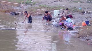 The everyday life of people in Myanmar. People wash and bathe in the river. Poor country.