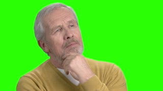 Thoughtful man, alpha channel background. Older pensive man, chroma key background. Maditation and imagination concept.