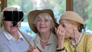 Three senior women taking selfie. Ladies smiling for a photo. Years pass but friends remain.