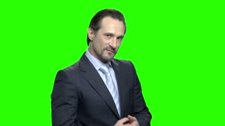 Thrilled angry businessman ready for fight. Portrait of aggresive caucasian man in suit. Green hromakey background for keying.