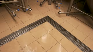 Tile floor in brewery. Top view tile floor in beer plant.