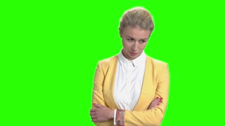Tired business woman with crossed arms. Young pretty business woman with arms crossed looking upset on chroma key background.