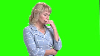Tired woman on chroma key background. Mature business woman looking exhausted and frustrated. Stress and depression concept.