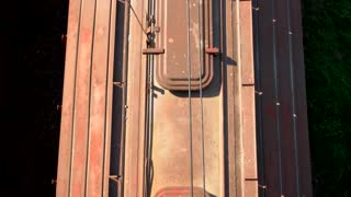 Top view train wagons. Freight train rides by rail, transports laden wagons.