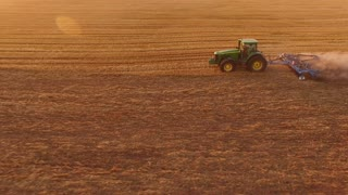 Tractor ploughing field. Rural economy development.