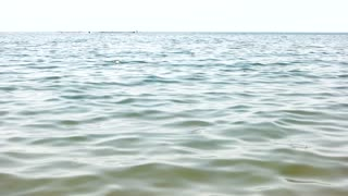 Tranquil sea water surface. Close up. Water background.