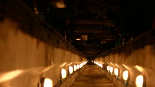 Tunnel illuminated lanterns. Long air-raid shelter. Concrete channel. Trench for laying communications. Pit for cables. Pit to repair cars.