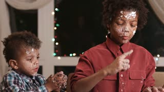 Two black boys destroying cake. Untidy black kids destroy cake. That awkward moment. Maybe it's time to stop.