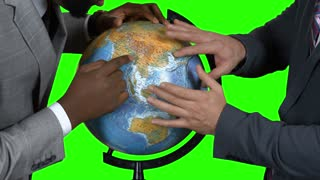 Two men with a globe. Businessmen on green background. Blurring the borders. Masters of the world.