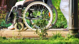 Ukraine, Kiev 17. 09. 2017. Riding wheelchair close up. Disabled person in the park walk.