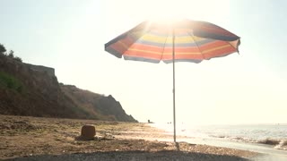 Umbrella on beach. Sky and seashore. Far from bustle and noise.
