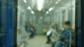 Underground carriage. People go home in the subway. Railway.