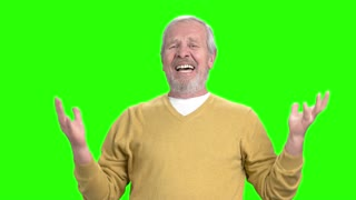 Unhappy depressed man gesturing with hands. Elderly dissapointed man on chroma key background. Human facial expressions. Nervous breakdown concept.