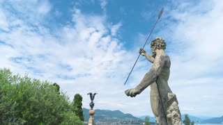 View from Isola Bella garden. Statue and beautiful landscape. Europe tourism guide.