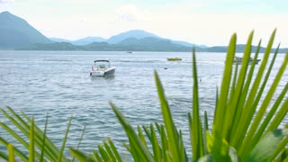 Water, boat and mountains. Italy in summer, scenic view. Fishing destinations in europe.