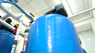 Water filters at the plant. Tanks and pipes. Renewed equipment works better. Modern technologies of water purification.