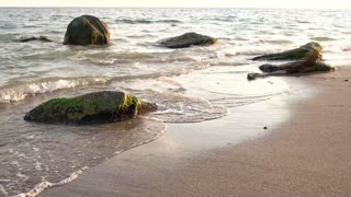 Water sand and stones. Sea in slow motion.