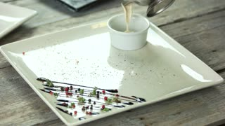 White creamy sauce. Plate with spices close up.