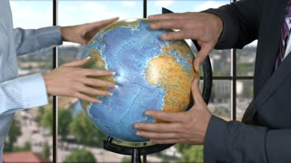 Woman and man with globe. Hands of business people. World isn't ready for changes. Plans of global scale.