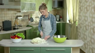 Woman cutting cabbage. Young female in the kitchen. Smart cooking tips.