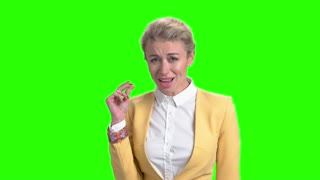 Woman is singing and looking at camera. Pretty elegant blonde singing and gesturing with hand on chroma key background. Beautiful lyrics performance.
