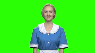 Woman with cleaner sprayer and toilet bottle. Attractive service woman or housewife. Green hromakey background for keying.
