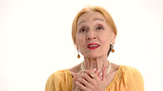 Worried old lady. Woman talking on white background. The honest story.