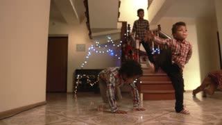 Young boys' Christmas dance. Kids breakdancing on the floor. Complexes don't exist. Young gentlemen demonstrating nice moves.