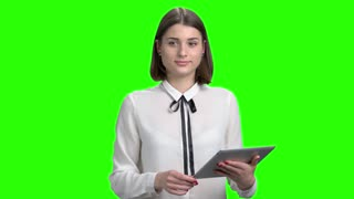 Young girl with tablet speech. Female manager on business conference presentation talking, green screen hromakey background for keying.
